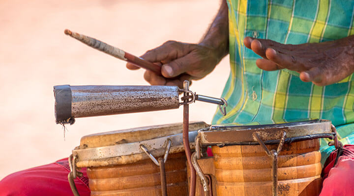 Man playing bongo drums